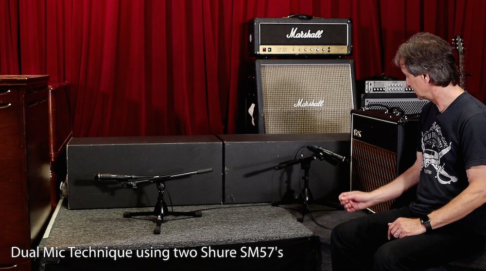One microphone, pointed away from the guitar amp