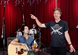Bob shows where he's placed a second microphone, to capture the room